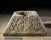 Opening of a well. This capital with a cross surrounded by broad acanthus leaves in relief comes from a 5th-century church. In a later date, possibly during the Ottoman Occupation, it was used as the opening of a well.