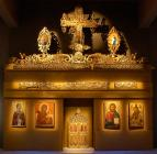 Parts of an iconostasis from the church of Saint Athanasios. They belong to different periods which correspond to different repairs and renovations of either the iconostasis or the church.  The frieze and the lypera dating from the earliest period of the iconostasis, namely mid-16th century, are on display to the right