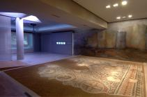 The only archaeological exhibit in the room is the mosaic floor, originally part of the triclinium (reception hall) of an urban villa dated in the 5th c. A.D. It was discovered during an excavation in Thessaloniki. It represents the personifications of the sun, the months, the winds and the signs of the zodiac circle combined with elaborate geometrical motifs